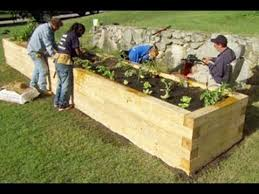 how to plant a raised garden bed this old house