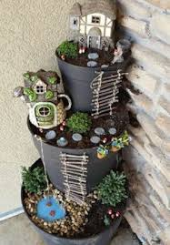 broken pot fairy garden from j j acres