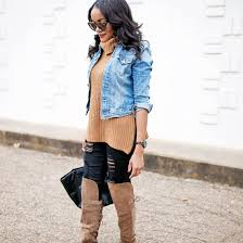 woman wearing jeans and sweater and boots and denim jacket