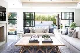 gray linen sofa with light wood coffee