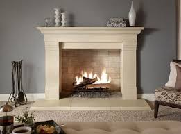 fabulous white stone mantel fireplace ideas with ceramic artworks display decors also grey wall