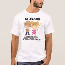 this t shirt is good for your husband as it has the 13th year wishes printed on it a lovely white t shirt with color print in the centre is always a