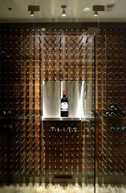 Custom aluminium magnum display in this glass enclosed wine cellar