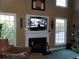 black tv above the fireplace with white frame placed on the brown wall on the middle