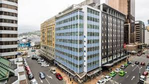 wooden office buildings. the leaders building on corner of featherston and brandon streets will be replaced by a wooden office buildings
