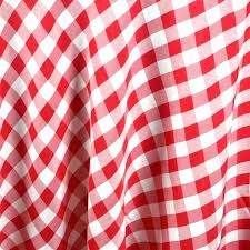 s red gingham tablecloth round and white fabric backg