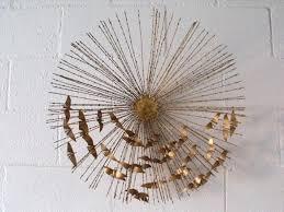 gold bird wall decor golden sunburst wall art flying birds centered modern contemporary like a palm