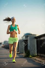 Running Woman. Runner Is Jogging In Sunny Bright Light On Sunrise ...