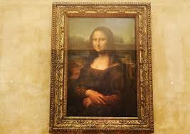 the famous leonardo da vinci painting the mona lisa seen on display in the louvre in