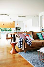 decorating brown leather couches. Bright White Space With Brown Leather Sofa And MCM Details // From The May 2015 Issue Of Inside Out Magazine. Styling By Emma O\u0027Meare. Decorating Couches O