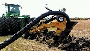 farm equipment performing tile draining