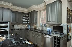 gray kitchen themes using painted kitchen cabinets also black granite countertop also corner wall cabinet