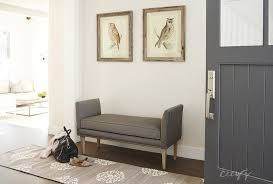 foyer with gray bench