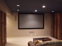 Home Theater Design Decor some small patching lamps on the ceiling and large screen on beige 60