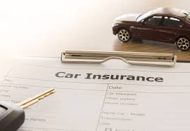 car insurance form with car model and key remote on desk