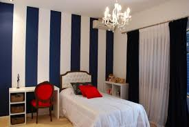 dark blue and white stripes painting for elegant bedroom ideas with red chair and charming white chandelier