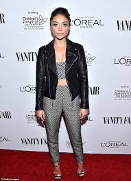ready to party sarah hyland looked stylish in a crop top and trousers two