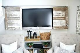 the best way to hide those a super simple industrial pipe sliding barn door tv white cabinet cover