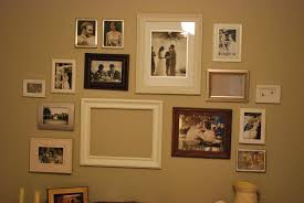 we got our wedding wall up in our master bedroom i still have two frames to finish but we re almost there