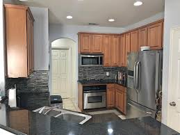 kitchen stainless steel appliances granite countertop cabinets pantry tiled flooring