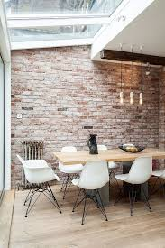 interior inspiration dining room kitchen brick back wall behind table red white rustic old brick