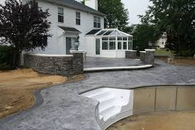 stamped concrete pool patio retaining walls and backyard hardscape