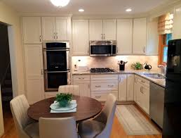 small white l shaped kitchen in naperville by adam hartig akbd fusion kitchen