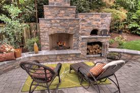 Outdoor Fireplace with pizza oven Traditional Patio Portland