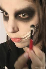 makeup artist demonstrates freaky makeup tutorial