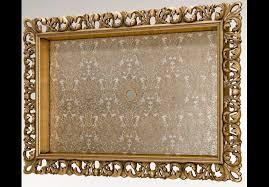 gold moldings bordered tv frame