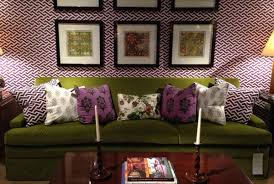 matching the purple geometric patterned throw pillows with the walls in this living room is a visual delight