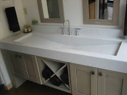 interior rectangle white trough sink on beige wooden floating bathroom vanity completed by small stainless