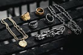 a rather unique collection of ancient looking rings bracelets necklaces and pendants that each look and feel like they have their own legendary story