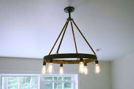 a custom bourbon barrel ring chandelier featuring 6 edison bulb made to order from knot 2 shabby custommade com