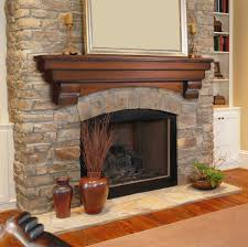 fireplaces accesories traditional wood fireplace mantel with stone wall surround brown decorative urns lacquered wood