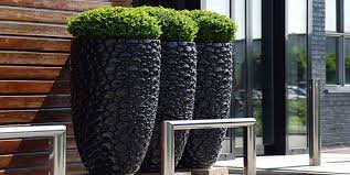 Pots work well in borders. Ways Pots Can Enhance Your Garden Design Healthy Housing