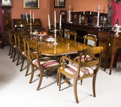 a beautiful contemporary regency style dining set which prises a burr walnut twin pillar dining table
