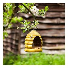 small wooden hanging bird house nesting