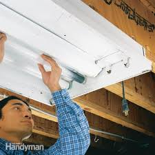 how to replace a fluorescent light bulb the family handyman fluorescent light fixtures repair how to