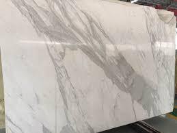 calacatta marble kitchen waterfall: calacatta   calacatta