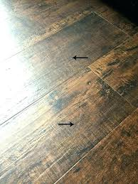 vinyl plank over tile flooring review how this waterproof vinyl plank performed one year over tile