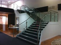 stainless steel barade with glass infill panels up staircase