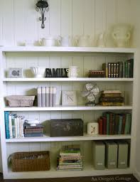 industrial cottage style living room shelves industrial accents vintage toolbox fan and books