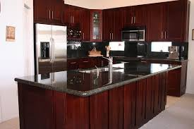 floor to ceiling kitchen cabinet with cherry material and black granite backsplash and countertop also