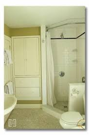 replacing glass shower doors with a curtain. love how this shower stall has been extended just a little to accommodate curtain which replacing glass doors with e