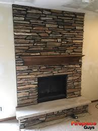large limestone hearth fireplace installation mn