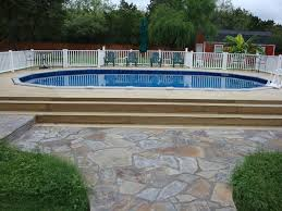 oval above ground pool with deck traditional pool