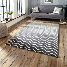 gray and white chevron rug white chevron design on a graduated grey background offer high levels