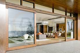 these large sliding doors and windows can have very simple seamless thresholds and sliding tracks as they can be top hung and work gorgeously to create