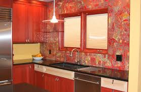 stunning red glass tile backplash with fish decor by john ryba